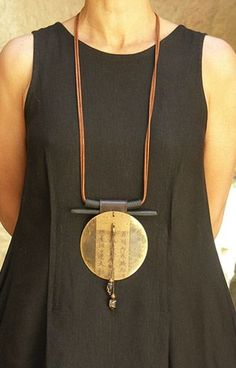 Long pendant necklace.