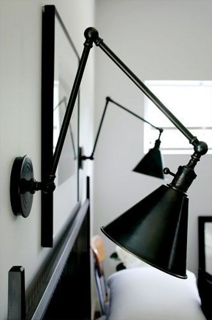 Black adjustable wall sconce reading lights.