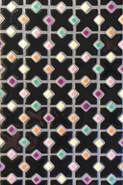 Playful porcelain tile mosaic in black with purple accents.