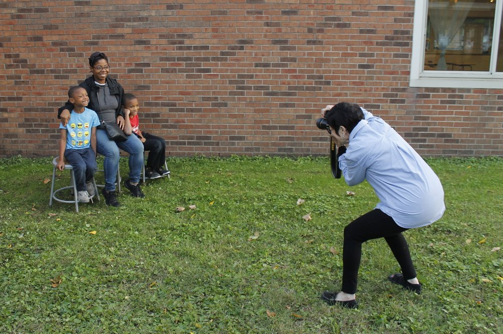 Peg taking family portraits at Fall Family Night - September 2018