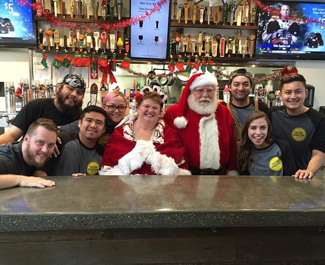 """#flashbackfriday to the first year open at our Anaheim location! We all made the """"Nice"""" list, so Mr. & Mrs. Clause stopped in to visit us!🎅🍻🤶 . . . #santa #elves #craftbeer #santalikesbeer #hedoesntlikemilk #drinklocal #visitanaheim #family #beerfamily #theironpress #theironpressanaheim #drinkbetterbeer #theanaheimpackinghouse"""