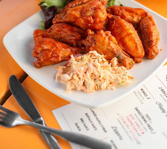 It's Wing It Wednesday! Come get a taste of our housemade Buffalo Sauce! Spicy, buttery and classic! These babies will have you licking your fingers! 📸: @skphoto.co