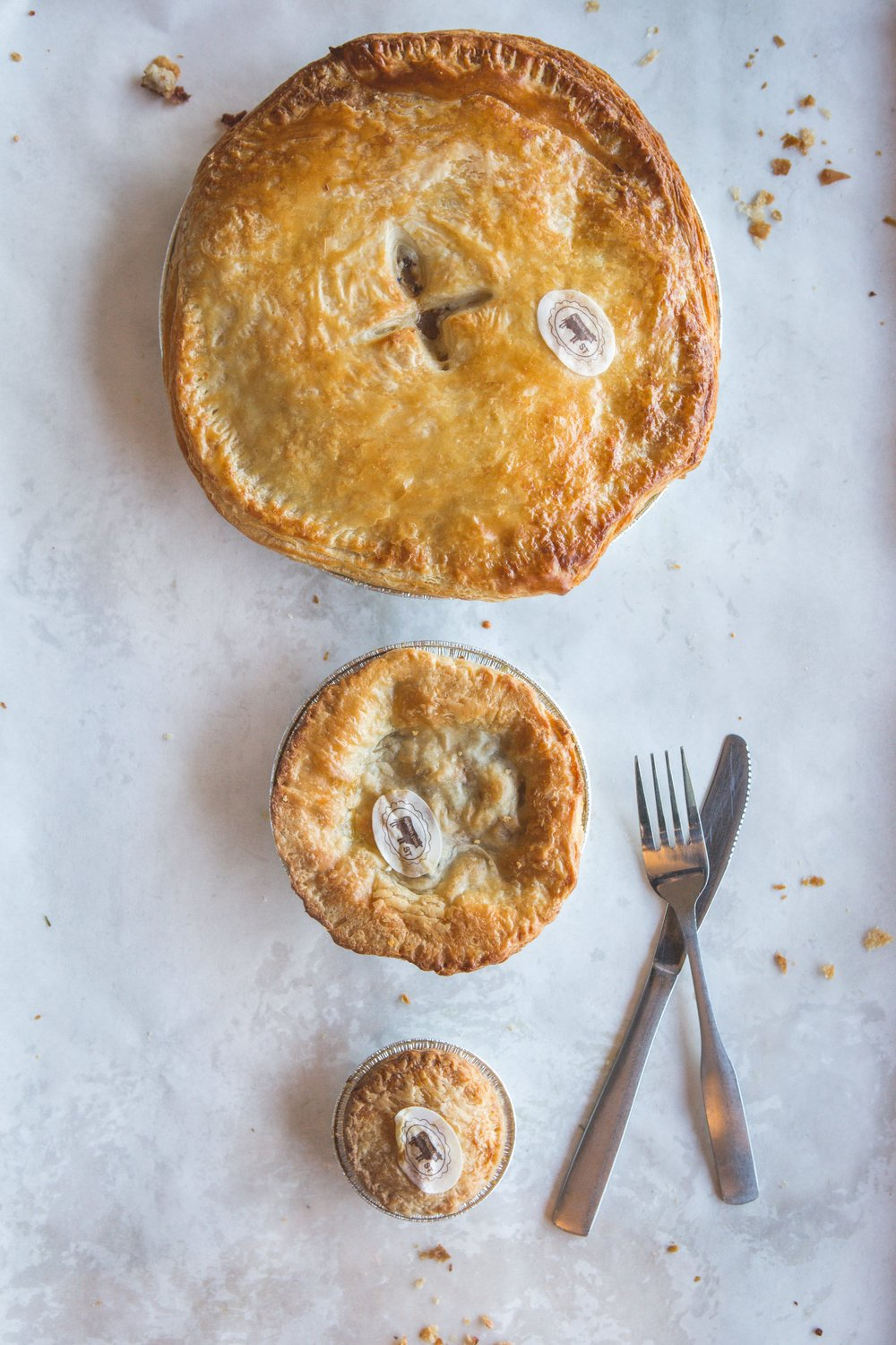 "All pies in 4 sizes -  Cuties, Even Cuters , 5"" personal and  9 inch family  - feed 6-8 - depending how hungry or greedy you are!"