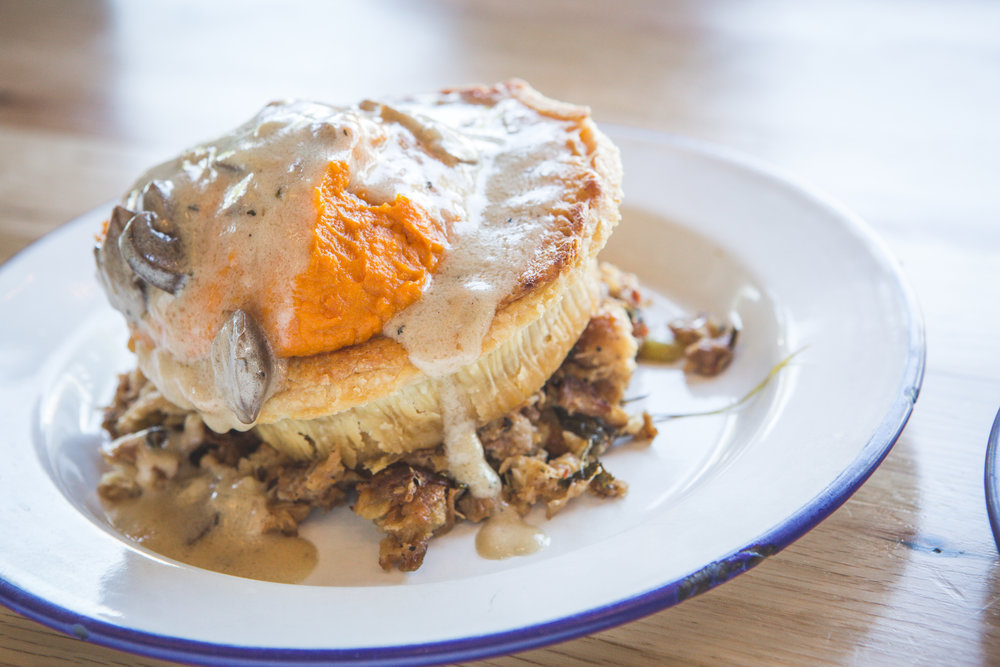 Tiger stack featuring Yams, Stuffing and Mushroom Gravy on a Steak and Shiraz pie