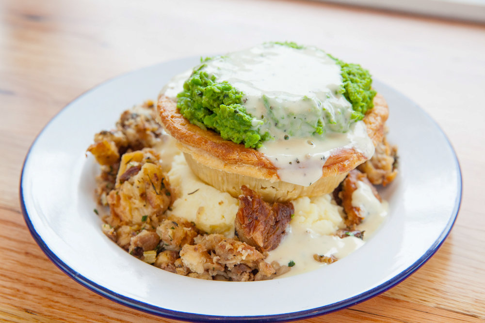 The TRIO Stack - featuring a Lamb & Rosemary pie, Sausage Croissant Stuffing & Yukon Gold Roasted Garlic Mashed potatoes and Minty Mushy Peas with Creamy Thyme Gravy.