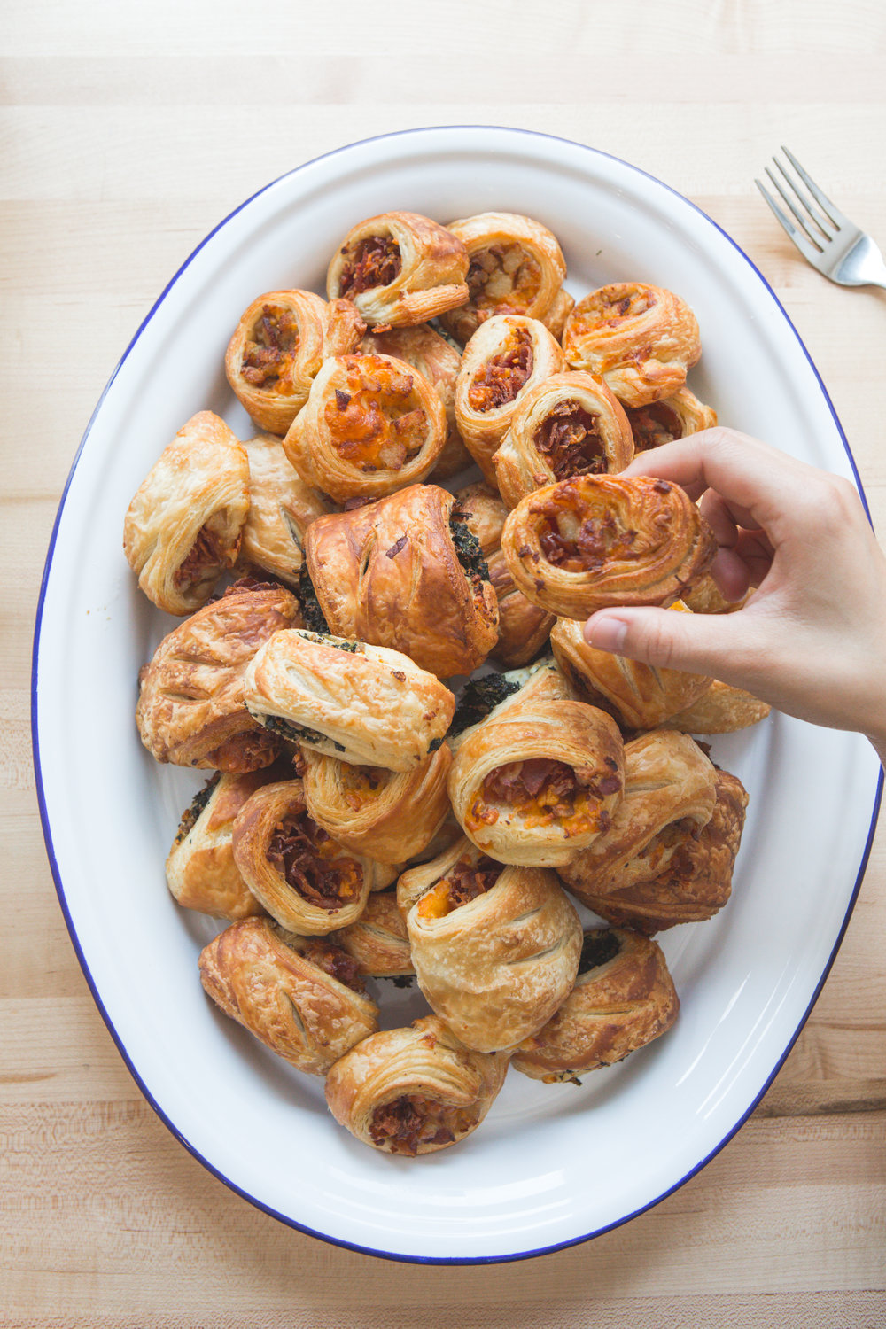 3 flavors of croissant rolls : Sausage & Cheddar, Bacon and Cheddar, Feta & Kale (V) These look like sausage rolls - but are made with croissant dough (not fillo or puff) and we add cheese. Available in 6 packs $15 and 12 packs $27.50 -by flavor.