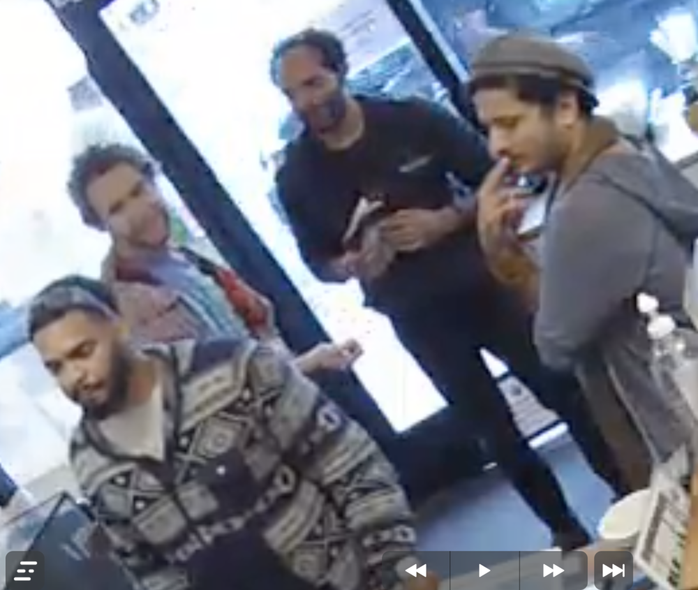 Who are the 2 guys in the back? Know them?  email us  with the info please so we can pass it on to the police