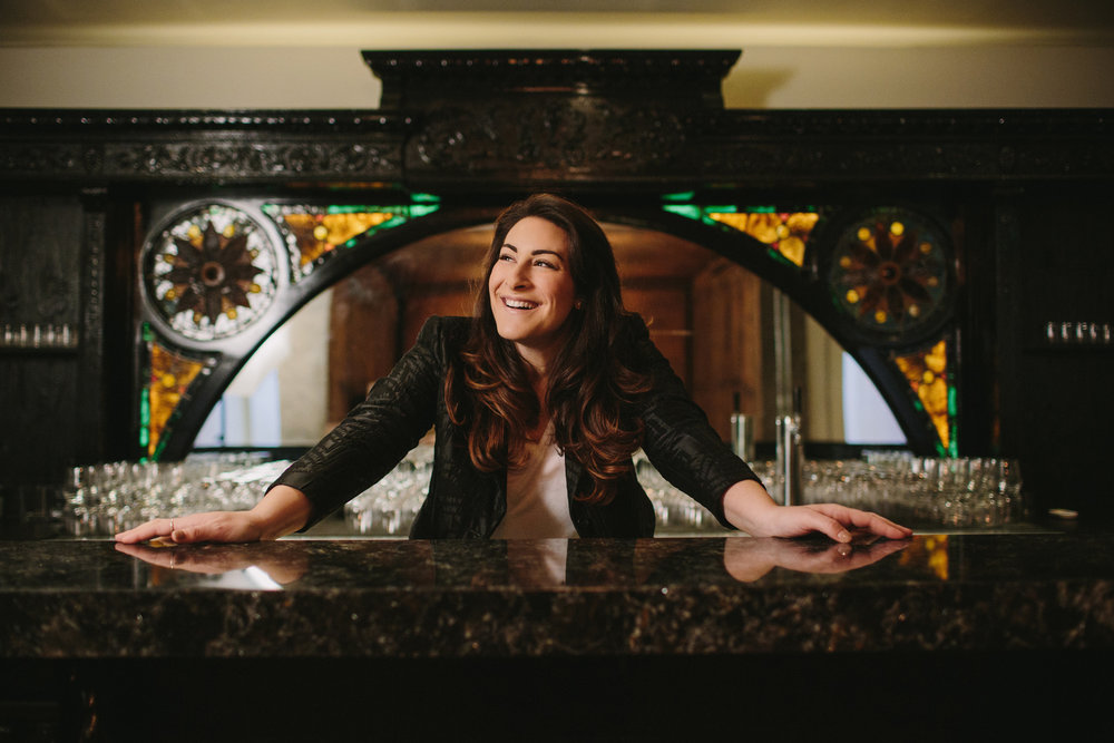 She's typically on the other side of the wood... but our art-glass bar makes one killer backdrop for GM, Louisa Cohen