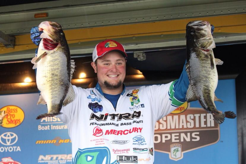 Joey with two stud Florida Largemouth at the Bassmaster Open