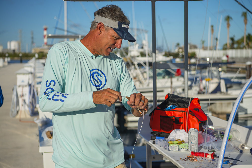 captain-scout-walker-rigs-swordfish-bait-before-fishing-on-into-the-blue-at-oceans-edge-resort