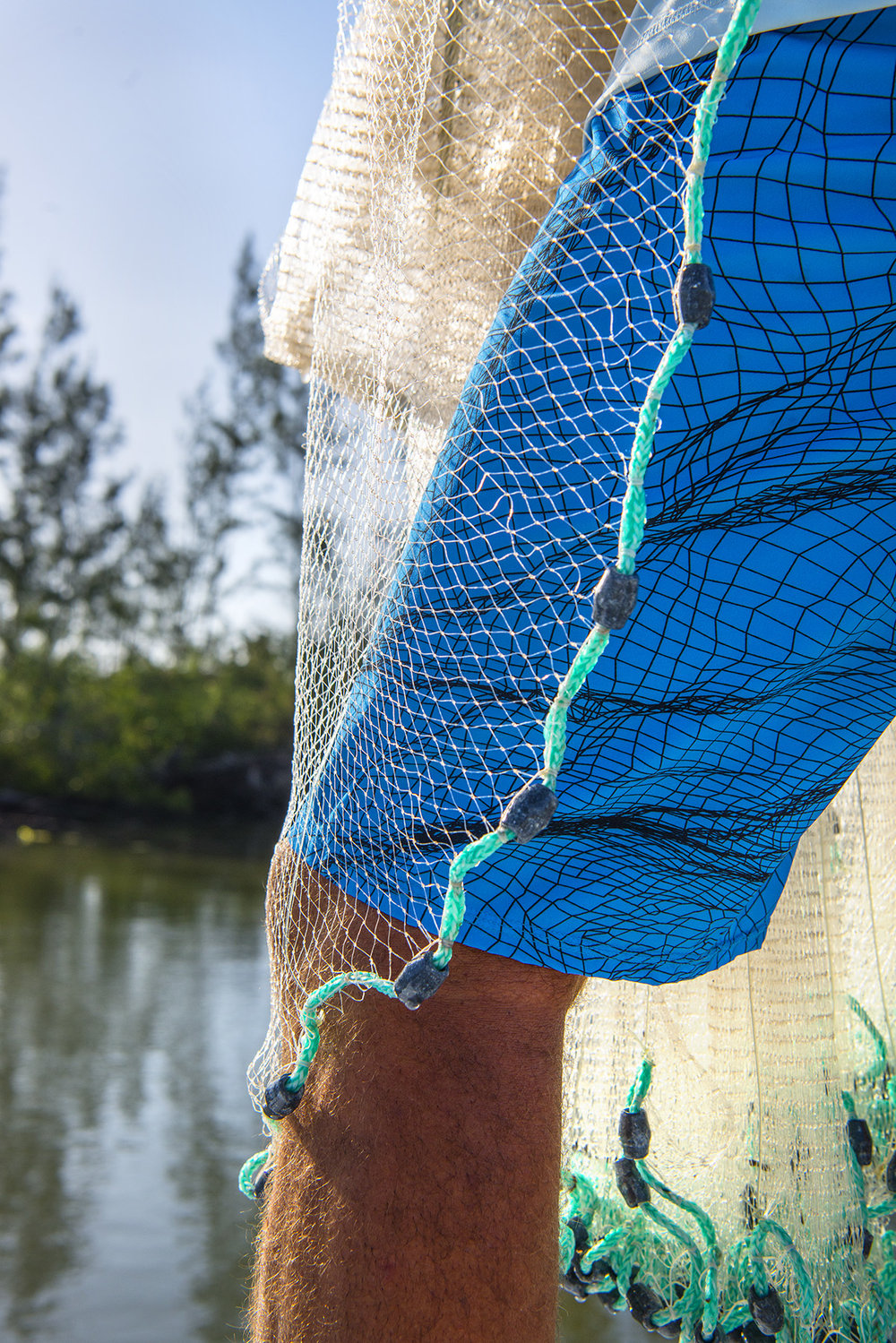 The art of cast netting into the blue fishing blog for Into the blue fishing