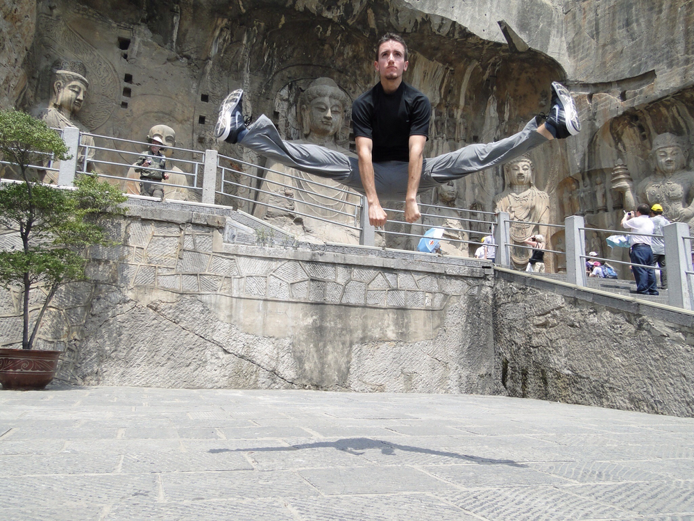 Demonstrating a jump kick at the Longman Grottos, China - 2010