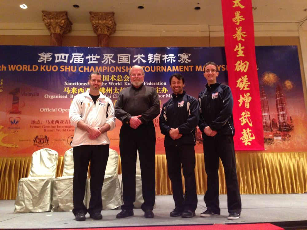 At the 4th TWKSF World Tournament, Malaysia - 2012 (Pictured with Grandmaster Lee, Master Buckley & Master Ozuna)
