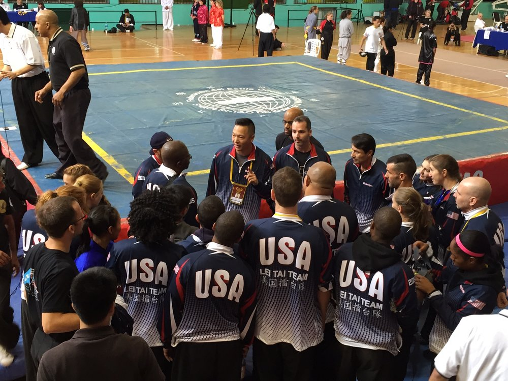 Master Michael Huang addresses the USA Lei Tai team (2015)