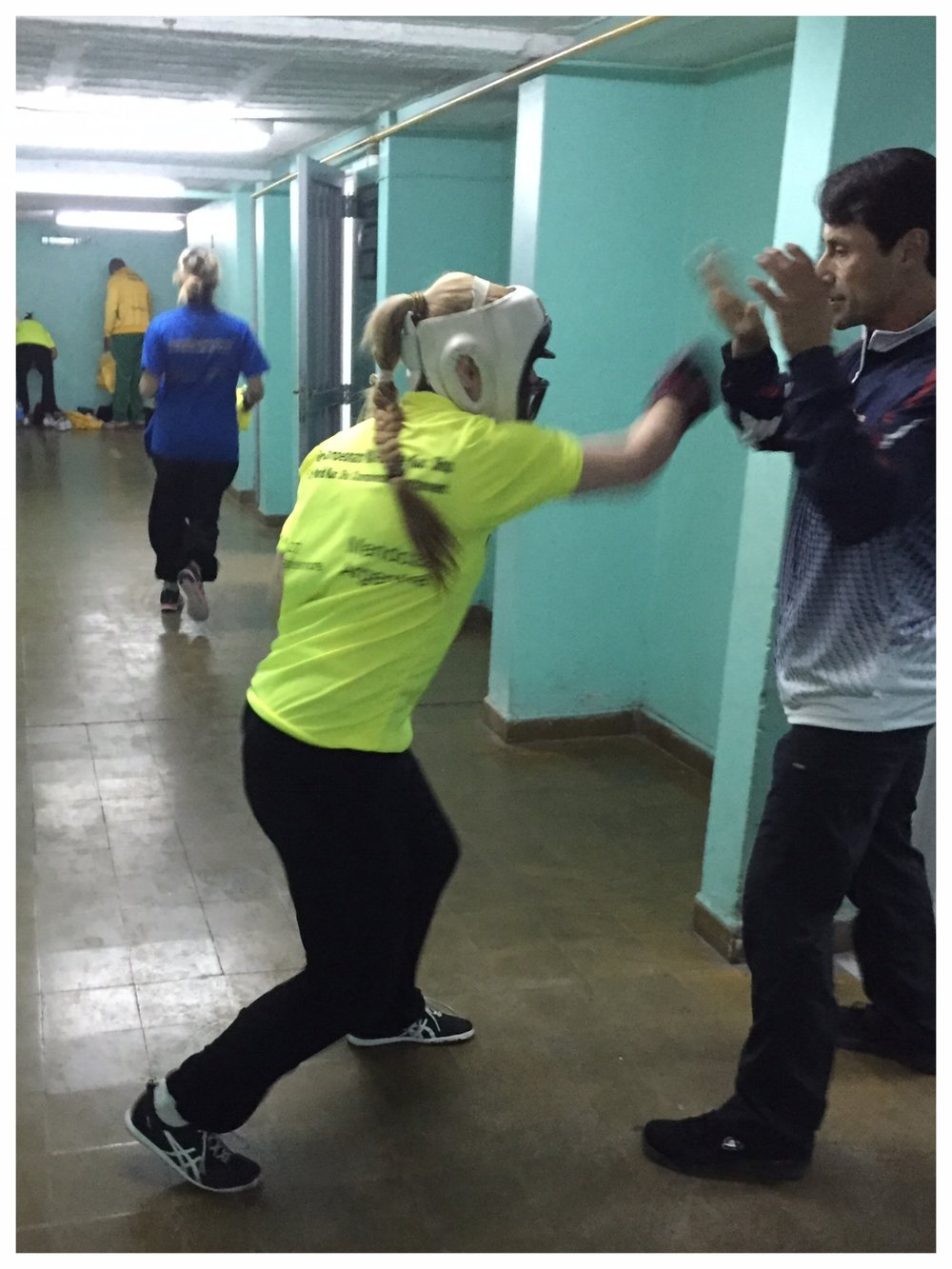 Katie Schmid prepares for her fight with Master Ozuna at the 5th TWKSF World Kuo Shu Championships, 2015