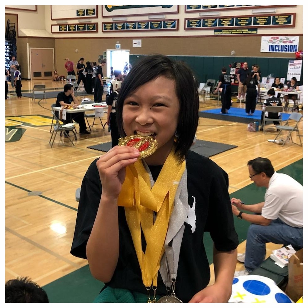 Danica Pham post-competition with all of her medals at the IBFDA US KuoShu Championship Tournament, 2018