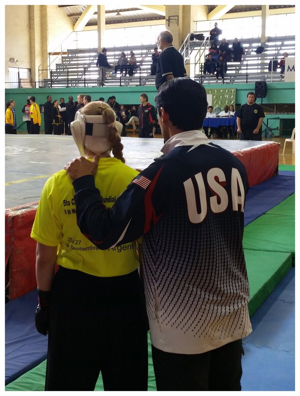 Master Ozuna coaches Katie Schmid before her second fight at the 5th TWKSF Championship Tournament in Mendoza, Argentina