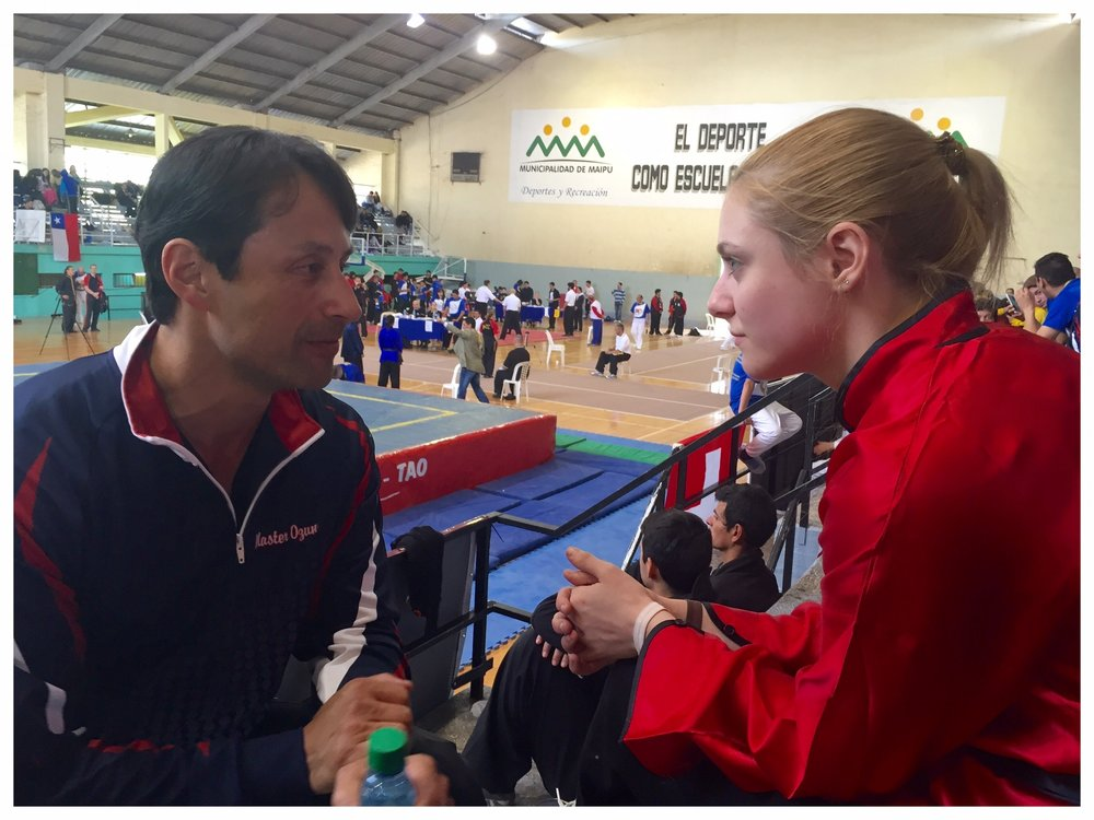 Master Ozuna coaches Katie Schmid between events at the 5th TWKSH Championship Tournament in Mendoza, Argentina