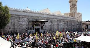 Syrians holding a rally to commemorate the occupation of Jerusalem, on the International Day of al-Quds, 2014. Image courtesy of Sana News.