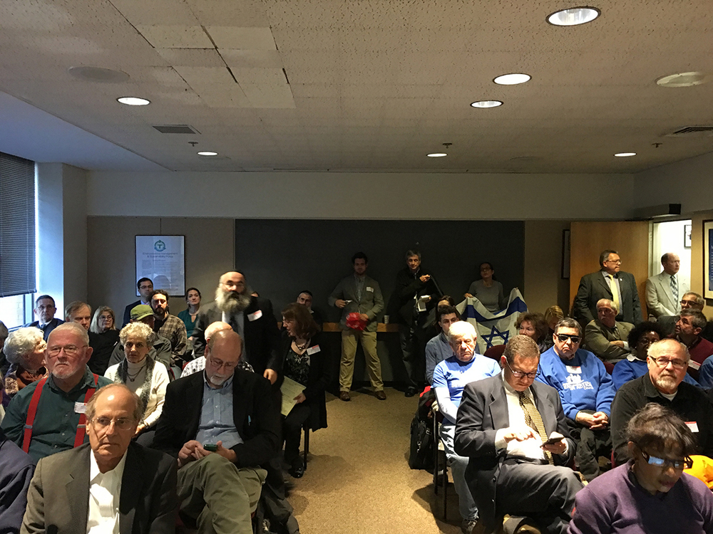 The packed boardroom at the MBTA headquarters. Photo by Boston Magazine.