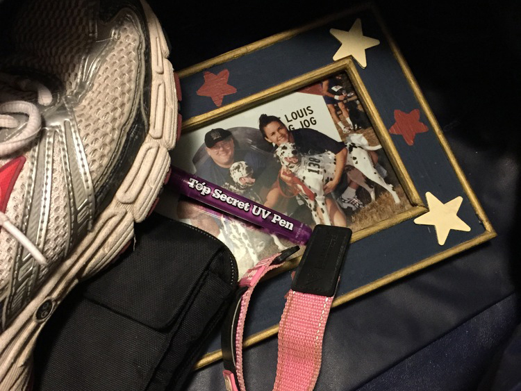 Author Laura Heitert's Me Bag contained items that would express her hobbies, special qualities and life outside of school. The items included a photo of her family members at that time, a purple pen, running shoes and her medical identification bracelet.