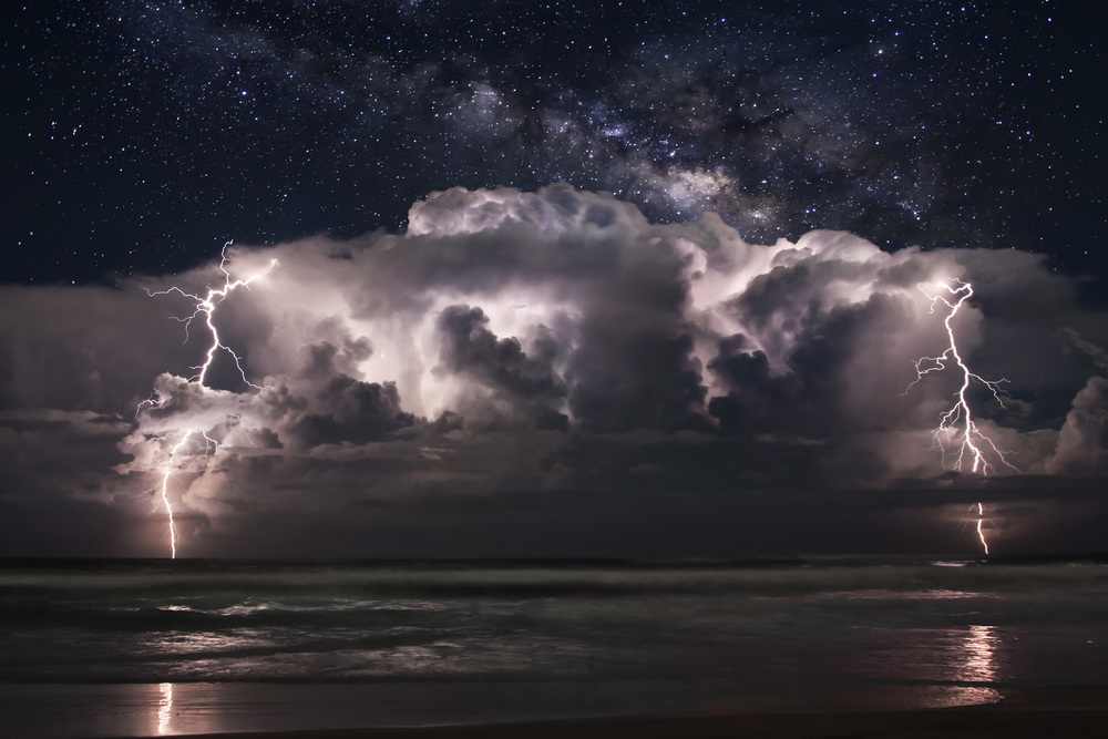 Thunderhead off the coast of Ormond Beach, Florida. Milky Way composite behind on October 12, 2011. 3 Image stack for lightning and stars.