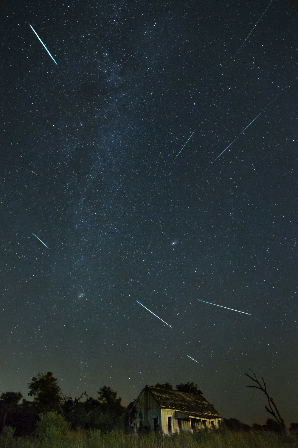 Perseid meteor shower over an abandoned house in Weir, Texas