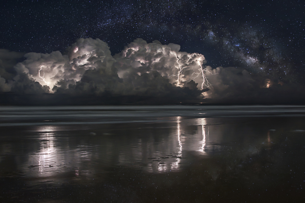 Cluster of storms off the coast of Ormond Beach, Florida with the Milky Way composited behind them on October 11, 2012. 4 image stack for lightning. 8 image panorama for Milky Way.