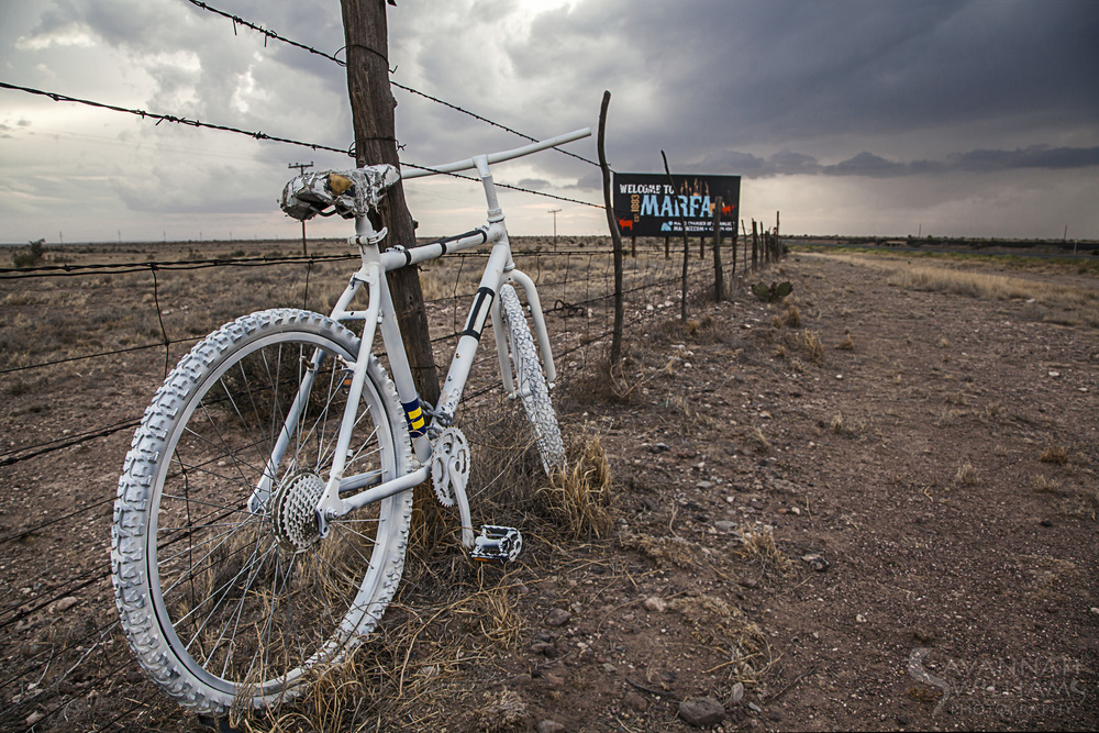 Ghost Bike along a fence near the Welcome to Marfa sign. Image credit: Savannah Williams