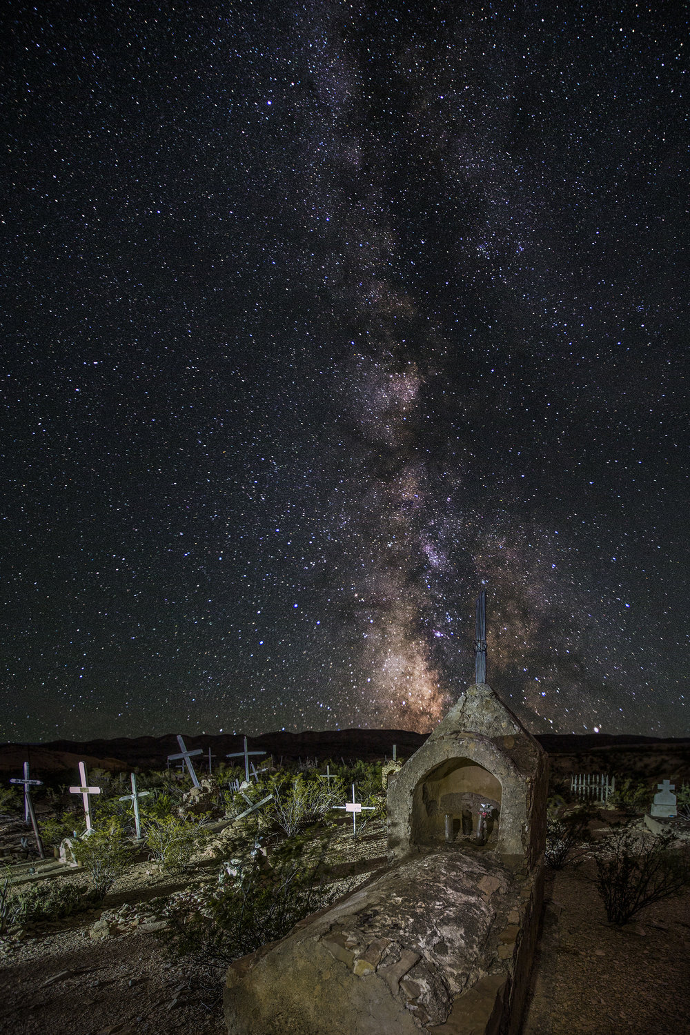 The Milky Way sets behind the boot hill cemetery in Terlingua.