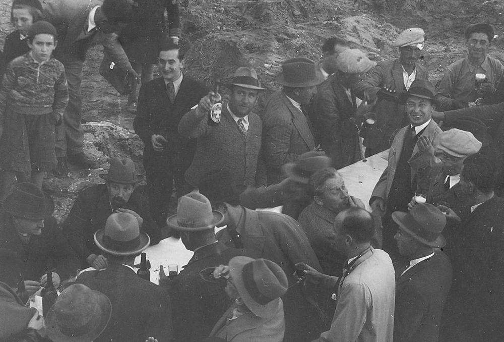 doron's grandfather , jacob dreksler, a building contractor. here on a project kick off with is his construction team in tel aviv israel 1934. (he is holding the wine bottle, looking at the camera, with the fedora type hat)