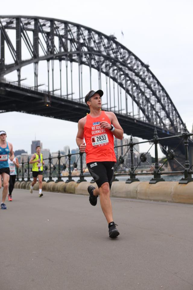 Tommy Callachor - half marathon pb - focused on pace and on the finish line 2k away!