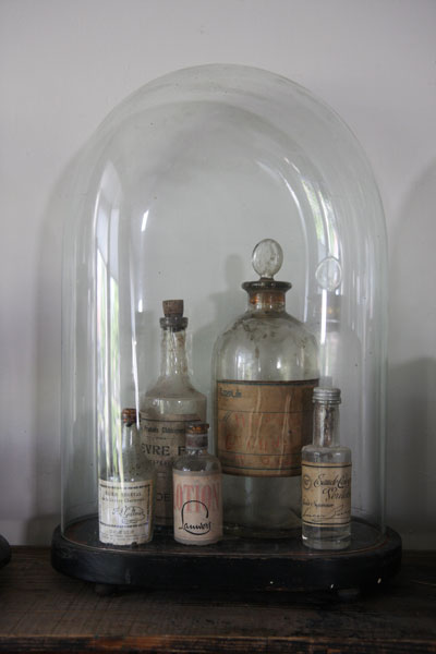 Under glass they look even more elegant - ah the art of the medicine bottle. More photos from this article