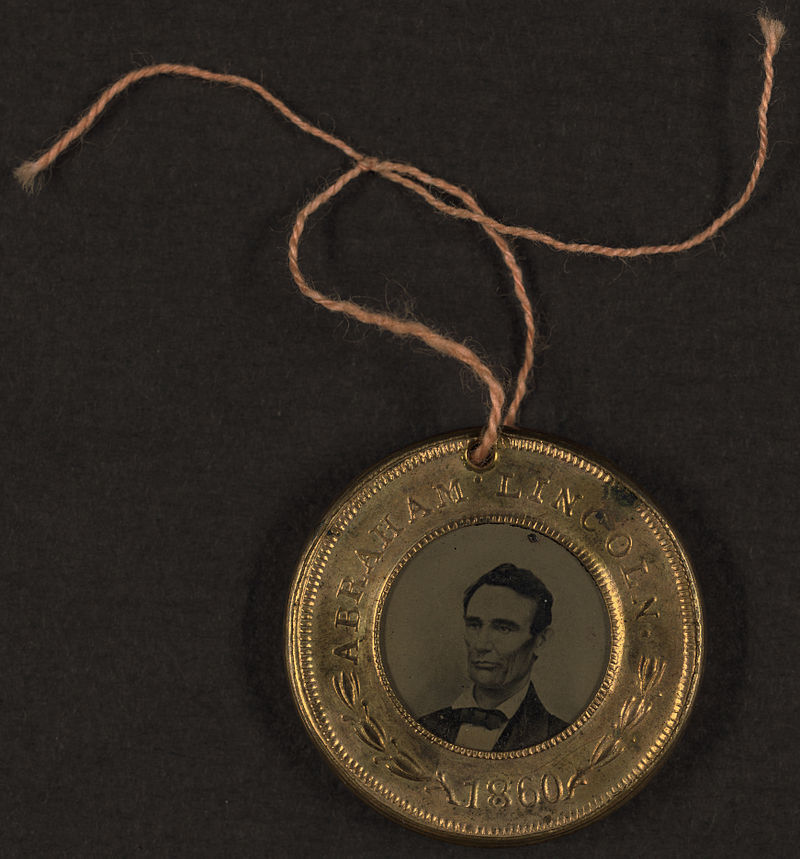 Look at this gorgeous example of Lincoln's campaign button from 1860 via wikipedia