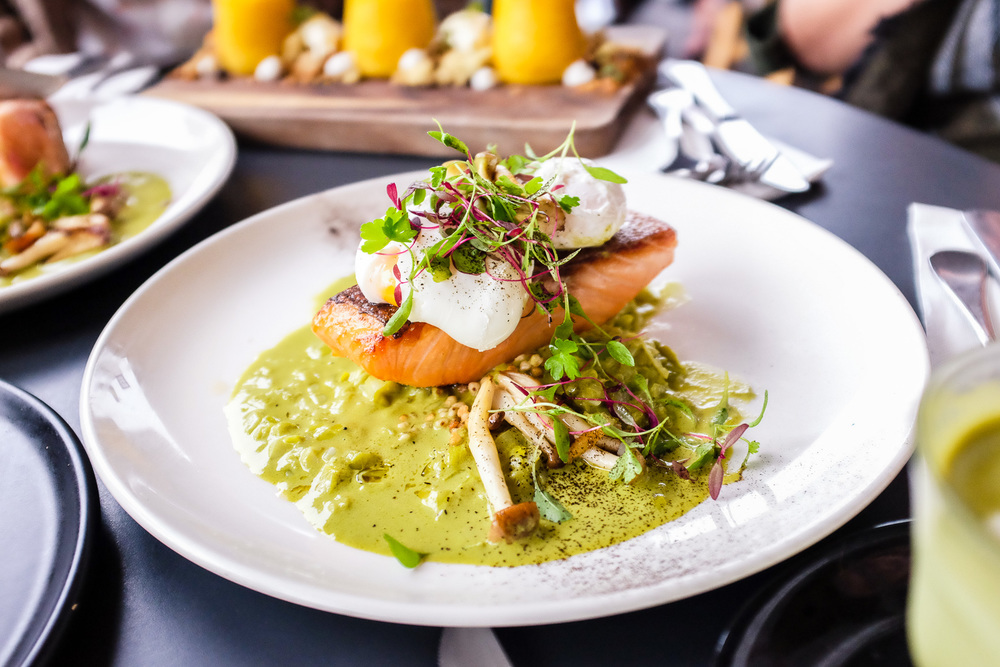Harvest smoked salmon fillet with two poached eggs, leek ash, toasted buckwheat, hon shimeji, braised leek, salmon caviar and butter lettuce jus ($26.50)