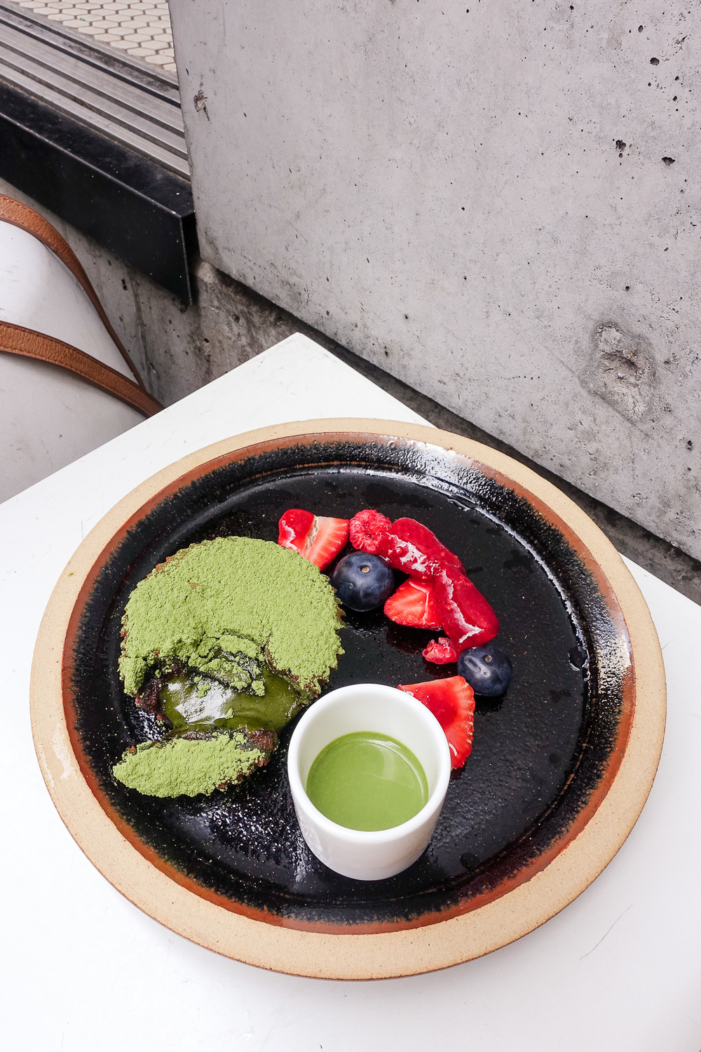 Matcha chocolate fondant, summer berries and matcha cream ($8.50)