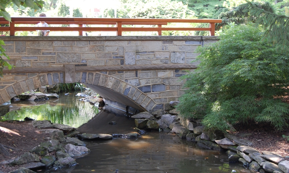 penn state hintz family alumni center stream bridge