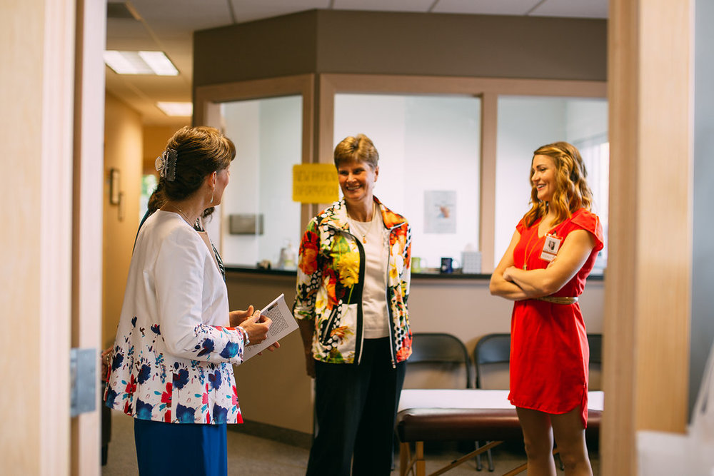 Dr. Auburn, Linda Huizenga and Carly Peterson prepare for visitors at our 8th annual open house at the natural health improvement center.  photo credit