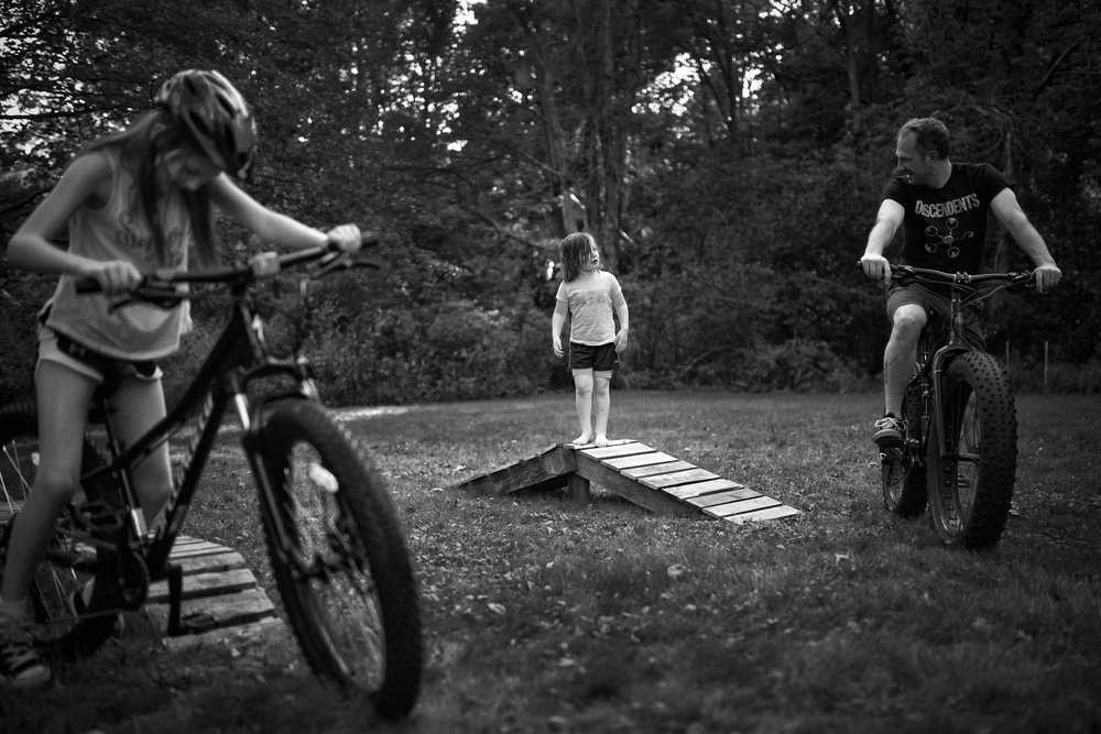 I married a man who is a doer. He can't sit still. He's incredibly active. And he takes this and gives it so whole-heartedly and creatively to our children. Current project: turning our yard into a mountain bike park. I support this. This is for him. This is for them. This is a shared experience I love to witness.   Photo by Olivia Gatti     Instagram  ::  Website