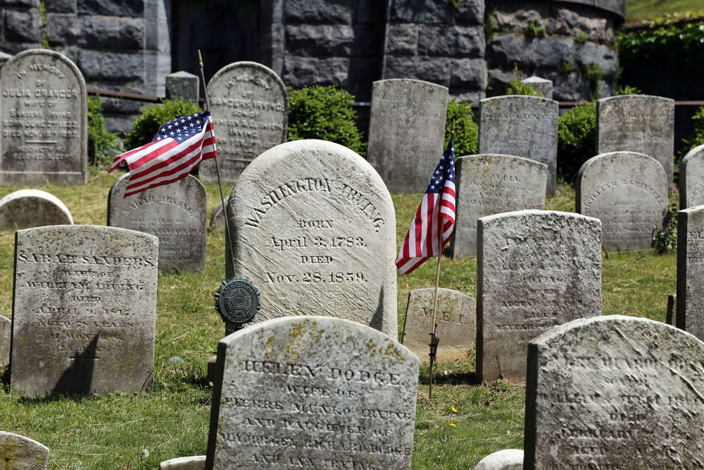 """Grave of  Washington Irving  (1783–1859), lawyer, diplomat, and internationally famous author of essays, short stories, histories, and biographies, notably """"The Legend of Sleepy Hollow""""."""