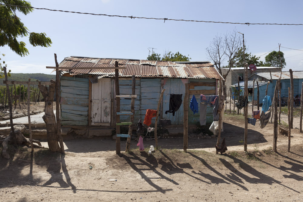 A house in one of the bateyes. It is common for people to hang their laundry on their fences to dry.