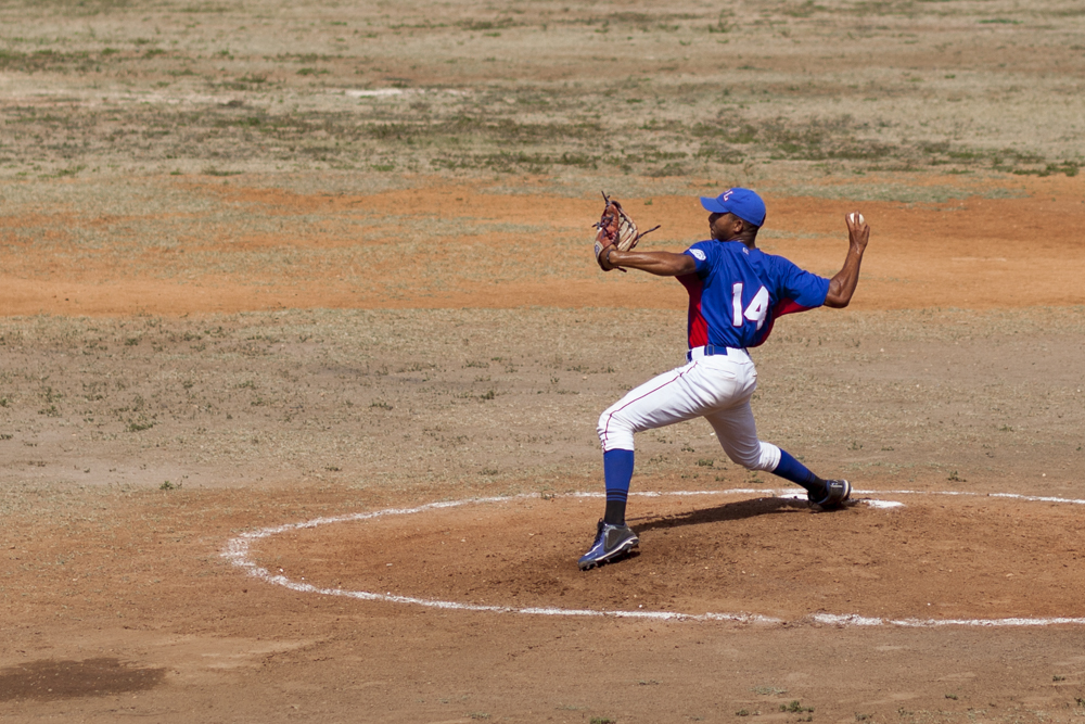 A pitcher during a pick-up game at the baseball stadium.