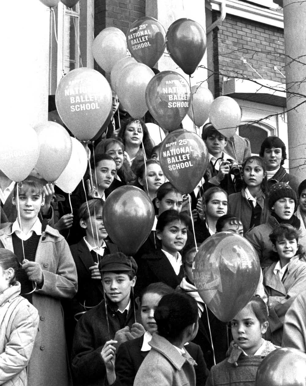 NBS students on the steps of the School celebrate NBS' 25th anniversary in November 1984.