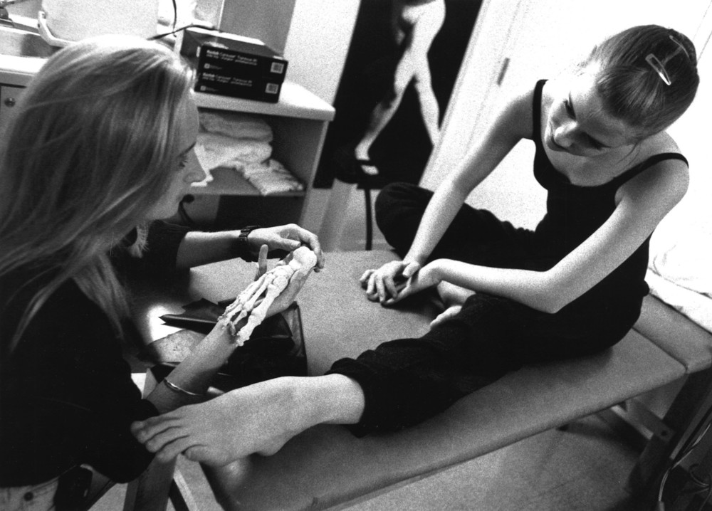 Sarah McCutcheon at work in the School's physiotherapy department, 1995.