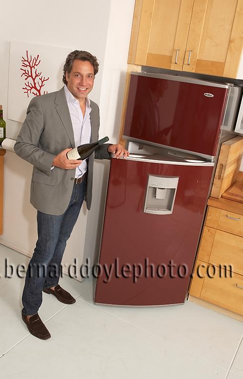 """Thom Filicia modeling the """"Quick Tap"""" fridge he designed for Amana ©2011www.bernarddoylephoto.com"""