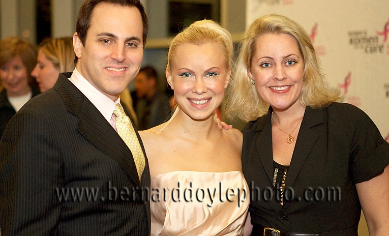 "Olympic Gold medal winning skater Oksana Baiul and comedian Ray Ellin on the red carpet at cancer benefit skating event ""Stand Up for Life"" (World Ice Events) ©2011 www.bernarddoylephoto.com"