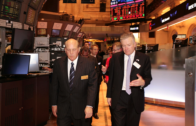 Celebrating Whirlpool's 100th year on the exchange,  Jeff Fettig, CEO of Whirlpool Corp, is given a tour of the exchange floor at the New York Stock Exchange by the CEO of NYSE, Duncan Niederauer     ©2011   www.bernarddoylephoto.com