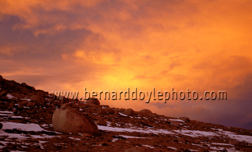 Inside the flame-red, sunset clouds on Pikes Peak, Colorado.  I don't think one can come closer to experiencing the surface of Mars anywhere else on Earth.    ©2011   www.bernarddoylephoto.com