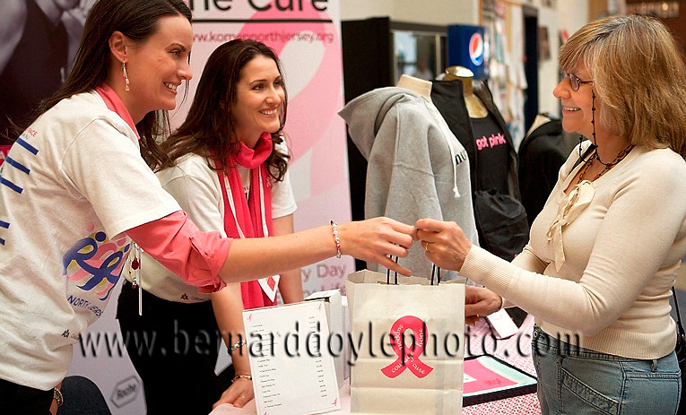"Volunteers assisting a happy attendee at an ice skating event to raise awareness for  ""Susan G Komen, Race for the Cure"", to find a cure for breast cancer.           ©2011   www.bernarddoylephoto.com"
