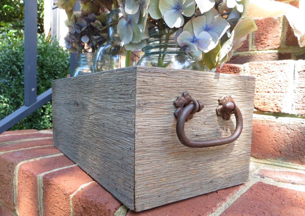Rustic cedar centerpiece with iron handles